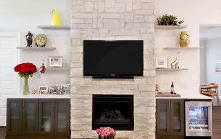 Entertainment Center with floating shelves, cabinets and fridge